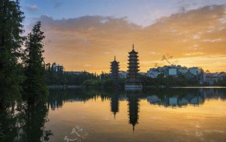 高塔日落旅游背景海报素材图片